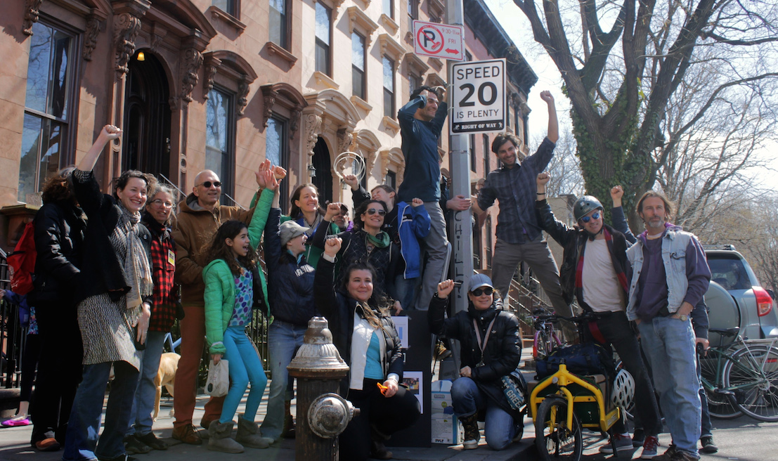 1395023590fists in the air group photo Guerrilla Group Posts Fake Speed Limit Signs